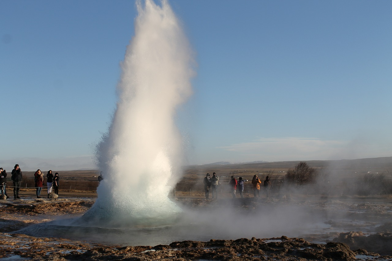 Tourists watching geyser in Iceland